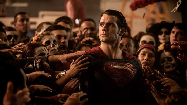 Henry Cavill is using one of two facial expressions he's allowed to use. There is 'serious' and 'angry' and that's it.